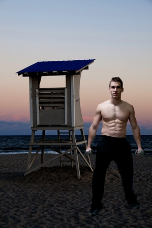 Beautiful attractive young fit muscular man standing photo