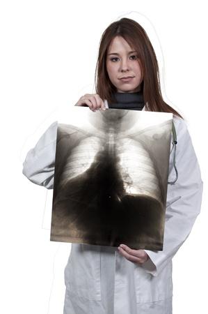 A beautiful female radiologist examining an x-ray Stock Photo - 12321305