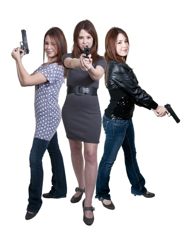 A beautiful police detectives women on the job with guns photo