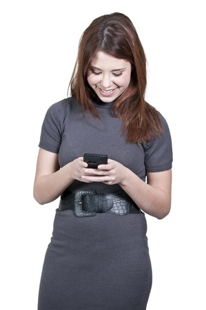 A beautiful young woman using a cell phone for texting photo