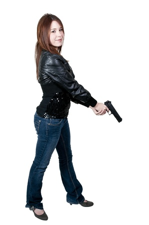 A beautiful police detective woman on the job with a gun Stock Photo - 12320978