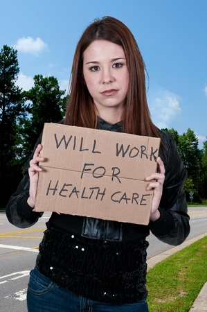 impoverished: A beautiful woman holding a sign that says will work for healthcare