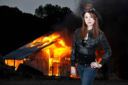 A beautiful woman firefighter at a fire Stock Photo - 12321314