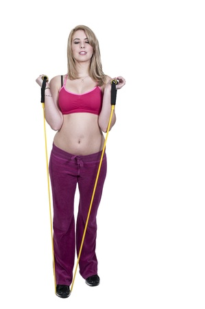 Beautiful young woman working out with resistance band tubes Stock Photo - 12314048