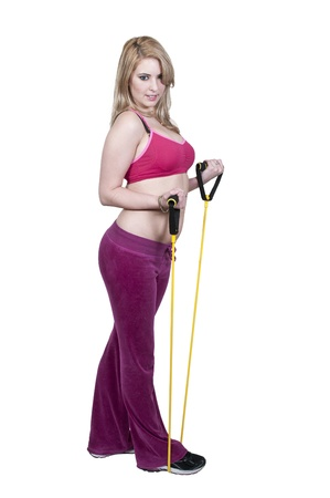 Beautiful young woman working out with resistance band tubes Stock Photo - 12314078