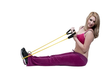 resistance: Beautiful young woman working out with resistance band tubes