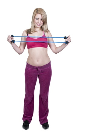Beautiful young woman working out with resistance band tubes Stock Photo - 12314115