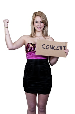 hitch hiker: A beautiful woman with a sign hitch hiking to a concert