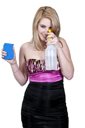 A glove wearing beautiful woman or maid cleaning house with a sponge and spray bottle with cleaner Stock Photo - 12321014
