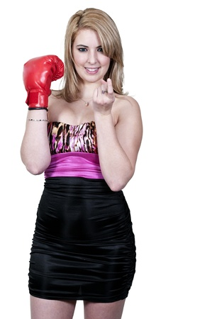 come hither: A beautiful woman in wearing a boxing glove breaking hearts Stock Photo