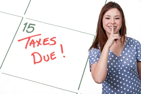 Woman and calendar reminder that Taxes are Due