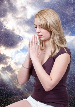 Beautiful Christian woman in a deep prayer photo