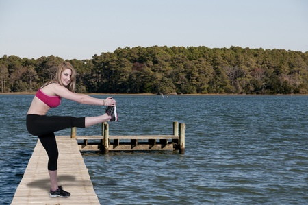 A beautiful woman doing her Yoga stance exercises