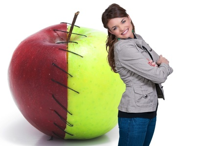 Beautiful woman standing beside a whole red delicious apple Stock Photo - 12314390