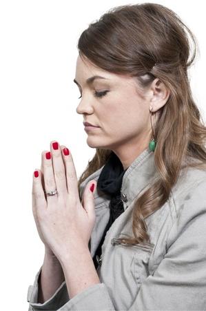 Beautiful Christian woman in a deep prayer Archivio Fotografico