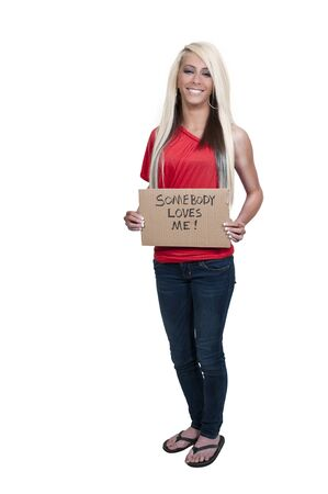 A beautiful young woman holding up a siagn that says I am not always strong Stock Photo - 12314464