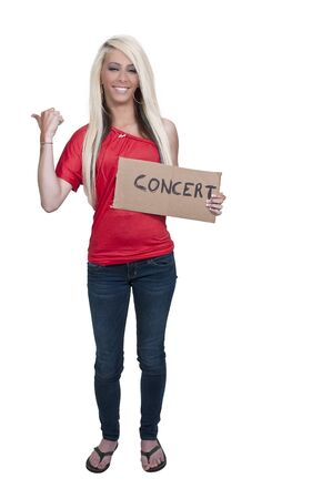 A beautiful woman with a sign hitch hiking to a concert Stock Photo - 12314111