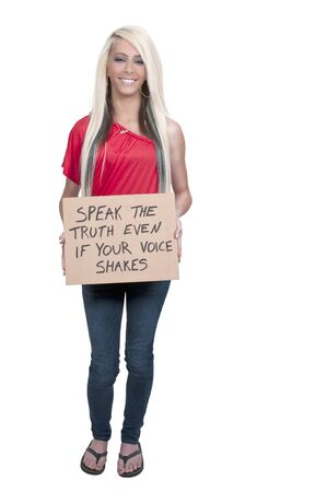 A beautiful young woman holding up a sign Stock Photo - 12319922