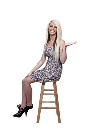 cane chair: A beautiful young woman looking far away