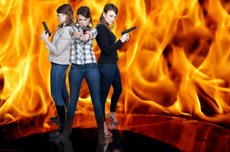 Beautiful police detective women on the job with guns in a fire Stock Photo - 12322141
