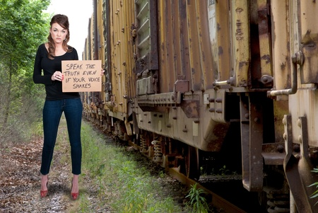 boxcar train: A beautiful young woman holding up a sign