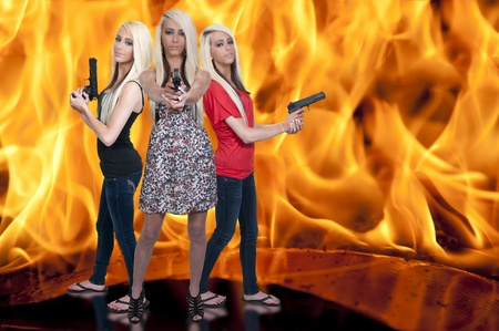 Beautiful police detective women on the job with guns in a fire Stock Photo - 12402662