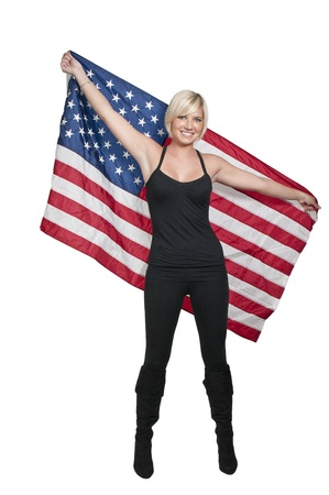 A beautiful young woman holding an American flag Stock Photo - 12551415