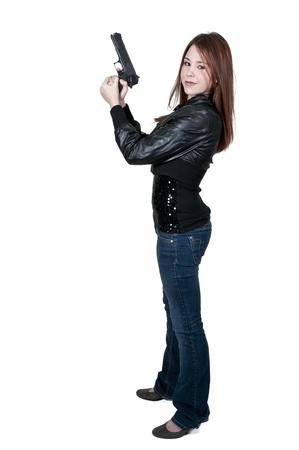 mujer policia: Un polic�a y bella mujer detective en el trabajo con una pistola