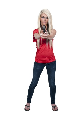 A beautiful police detective woman on the job with a gun Stock Photo - 12551044