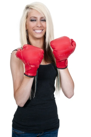 A beautiful young woman wearing a pair of boxing gloves