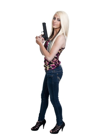A beautiful police detective woman on the job with a gun Stock Photo - 12551378