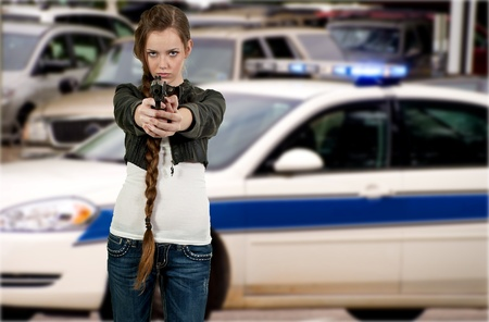 law enforcer: A beautiful police detective woman on the job with a gun