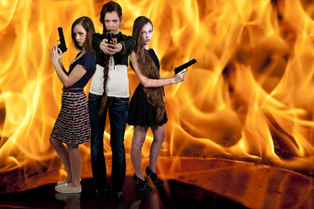 Beautiful police detective women on the job with guns in a fire Stock Photo - 12551600
