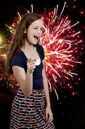 A flirting young Beautiful Woman teenager winking and smiling and pointing Stock Photo - 12551597