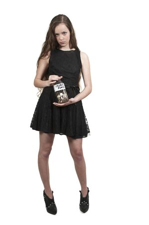 teenaged: A beautiful woman holding her college fund of coins in a milk bottle