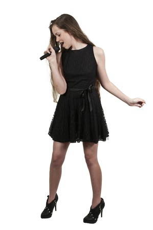 A beautiful teenage woman singer performing at a concert photo