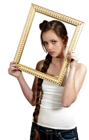 narcissism: Beautiful woman looking through an ornate picture frame