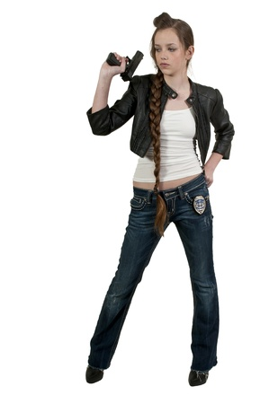 federal police: A beautiful police detective woman on the job with a gun