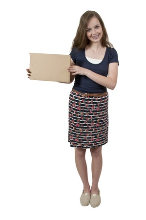 teenaged girls: A beautiful young teenager woman holding up a blank sign Stock Photo