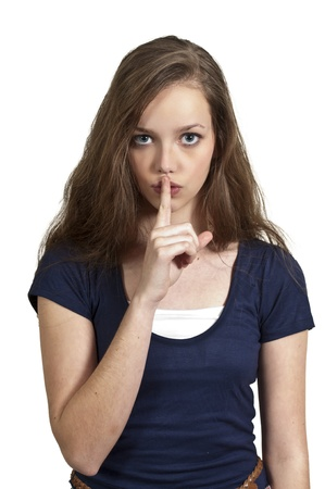 A woman saying be quiet by saying shhh photo