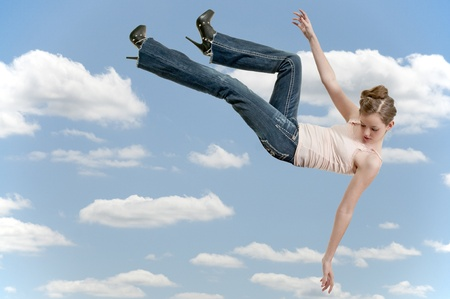 A beautiful young teenage woman falling through the sky Stock Photo - 12547420