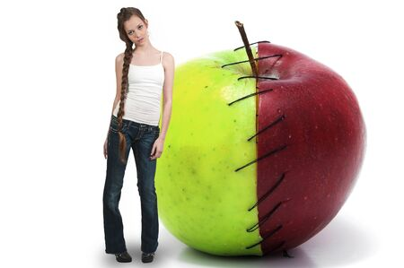 winesap apple: Beautiful teenage woman standing beside a whole red delicious apple with a nutrition label