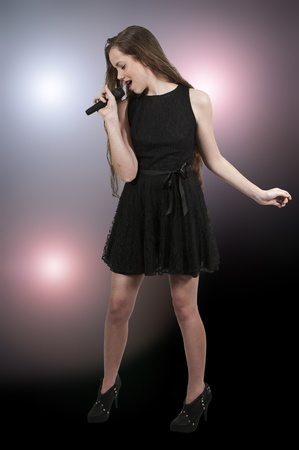 A beautiful teenage woman singer performing at a concert Stock Photo - 12551072