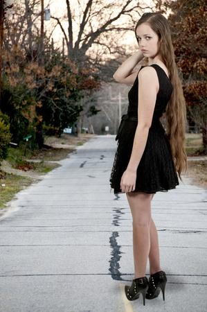 Een jonge mooie vrouw tiener meisje poseren