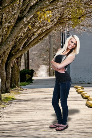 teenaged: A beautiful young blonde haired teenage woman with a big smile Stock Photo