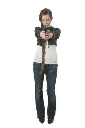 A beautiful police detective woman on the job with a gun Stock Photo - 13190554