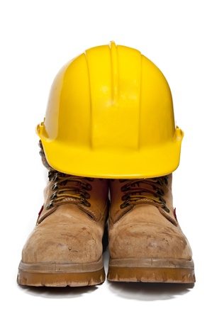 Construction PPE - Steel toe boots and a yellow hard hat Stock Photo