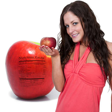 A whole red delicious apple with a nutrition label photo