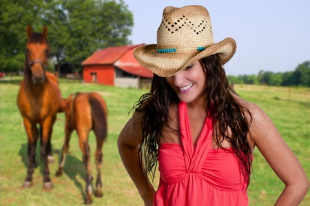 sexy cowboy: Beautiful young country girl woman wearing a stylish cowboy hat