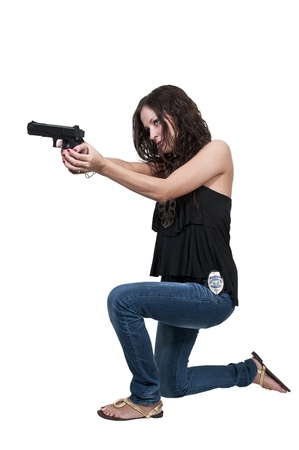 firearms: A beautiful police detective woman on the job with a gun